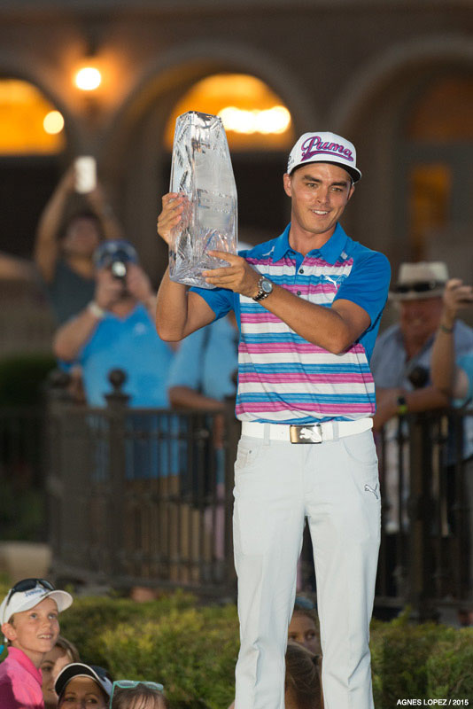 THE PLAYERS 2015 Champion Rickie Fowler holding the trophy - photo by Agnes Lopez