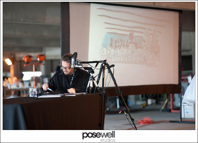 Artist Michael Arthur live-drawing the event