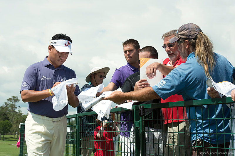 PLAYERS Champion KJ Choi signing autographs at TPC Sawgrass from THE PLAYERS 2013 by Agnes Lopez