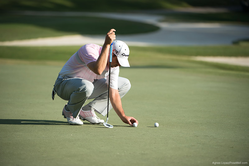Sergio Garcia placing his ball to putt at TPC Sawgrass from THE PLAYERS 2013 by Agnes Lopez