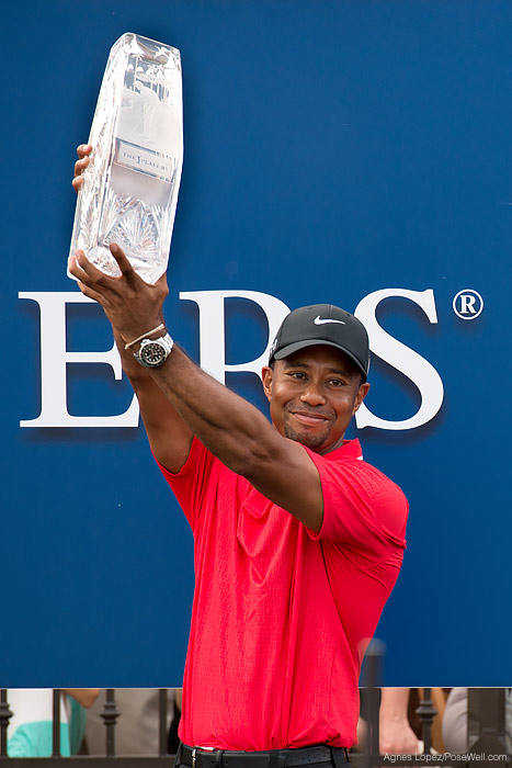 Tiger Woods holding the The 2013 PLAYERS Championship trophy by Agnes Lopez
