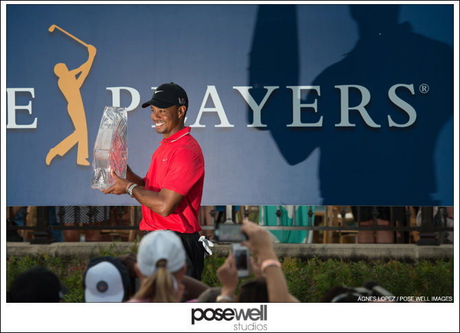 Tiger Woods holding the Players Championship trophy - photo by Agnes Lopez